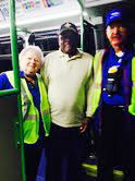 First paying passenger on the Allen route 301, Haywood Brown, is greeted by TAPS drivers Clara Box and Walter MacGruder.